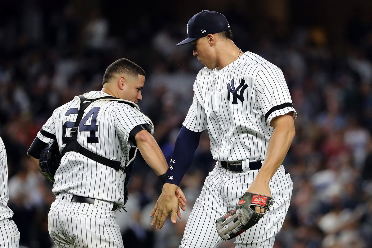 Gary Sanchez and Aaron Judge celebrate after defeating the Houston Astros 5-0 in Game Five of the American League Championship Series at Yankee Stadium on October 18, 2017.