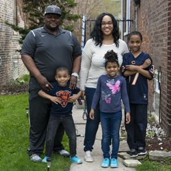 The Norwood family stands in front of their home, Tuesday, April 28, 2020.