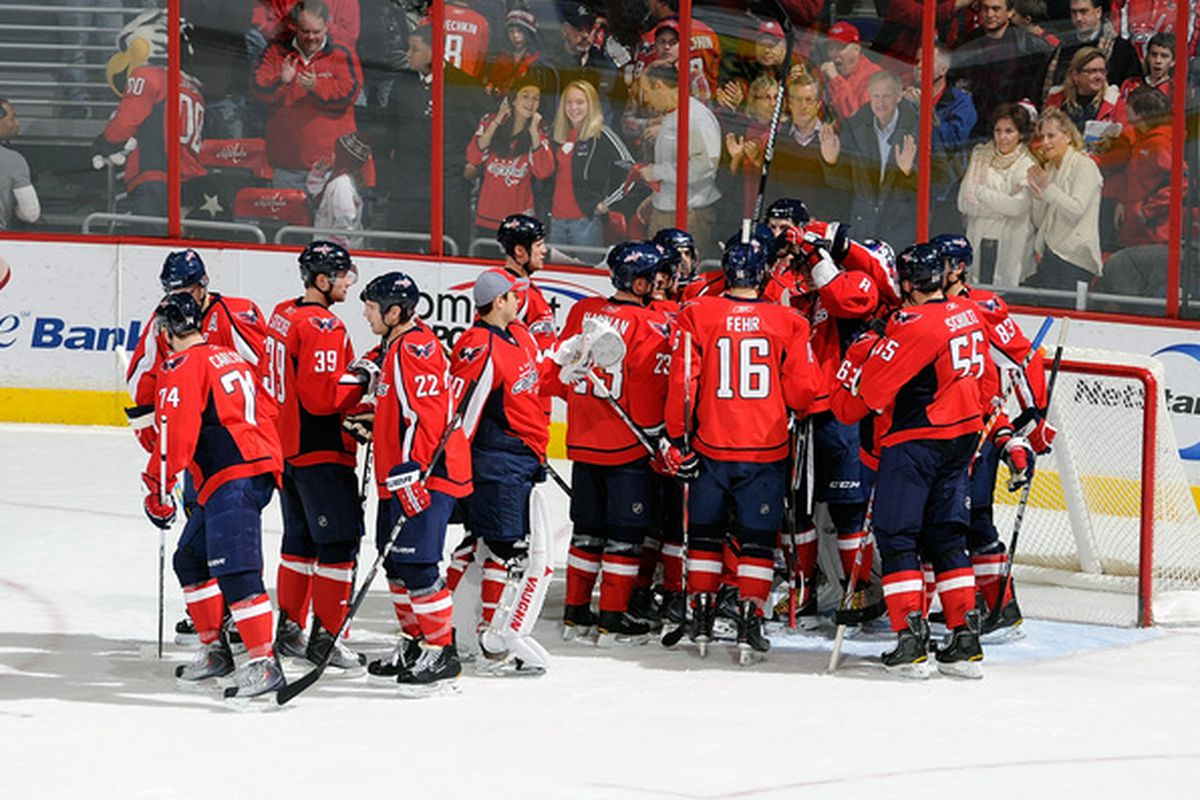 WASHINGTON - JANUARY 08:  Semyon Varlamov #1 of the Washington Capitals is congratulated by teammates after a 3-2 victory against the Florida Panthers at the Verizon Center on January 8 2011 in Washington DC.  (Photo by Greg Fiume/Getty Images)