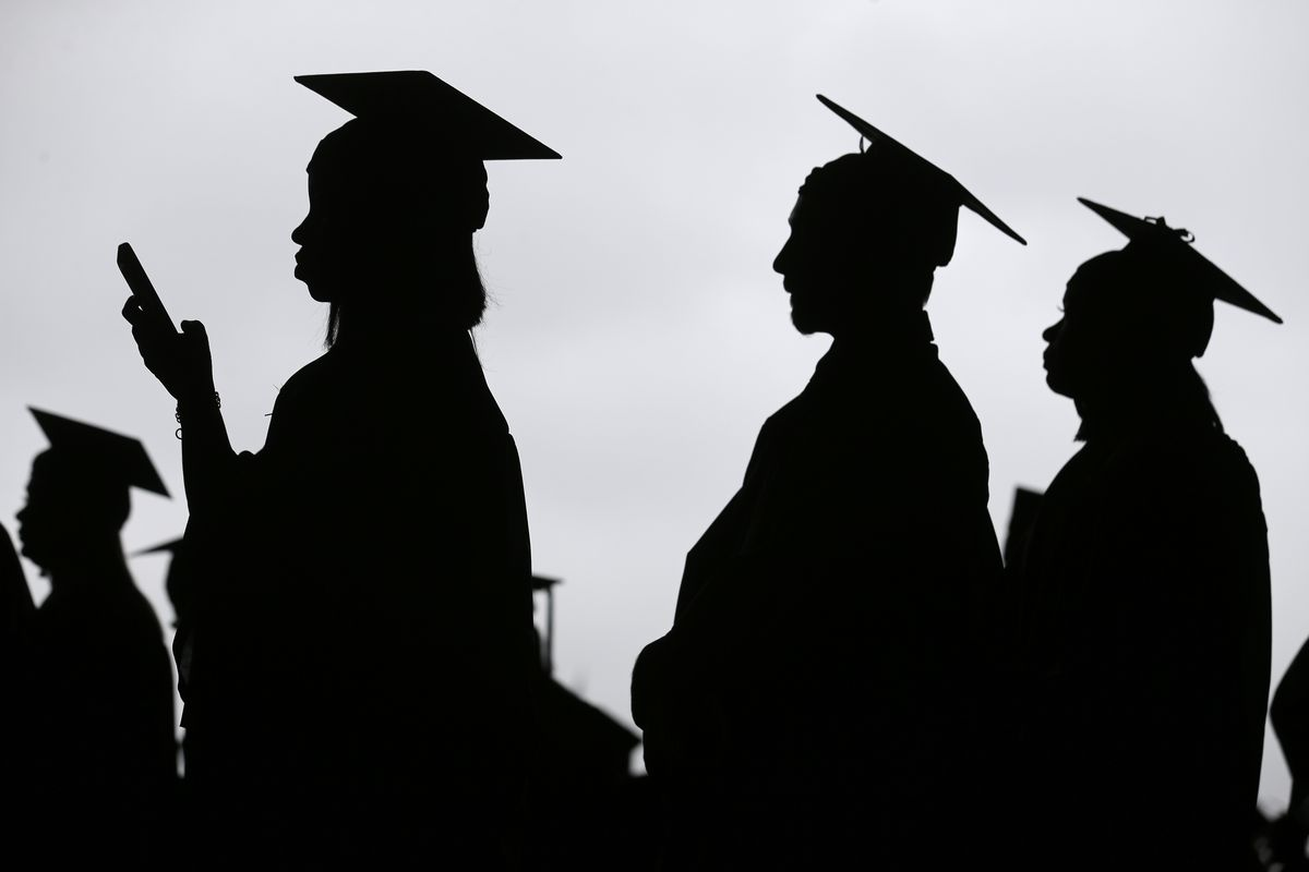 FILE- In this May 17, 2018, file photo, new graduates line up before the start of the Bergen Community College commencement at MetLife Stadium in East Rutherford, N.J. Obtaining a college degree has increasingly coincided with ever-higher student debt loa
