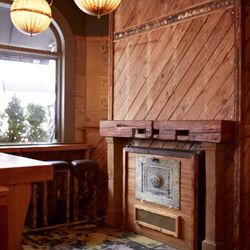 Wood and vintage pieces make up the fireplace