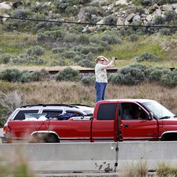 A motorist takes a picture of stalled traffic on I-80 Saturday after a fiery crash that killed one person. Traffic was halted in both lanes after a FedEx semitruck hauling three trailers collided with a Dodge Dakota near the Salt Lake-Tooele border, killing the driver of the Dakota and injuring the FedEx driver.