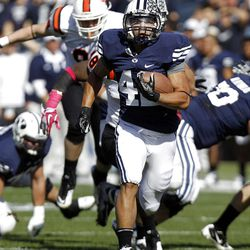 Brigham Young Cougars running back Michael Alisa runs for a touchdown as Brigham Young University faces Idaho State in NCAA football in Provo, Saturday, Oct. 22, 2011.