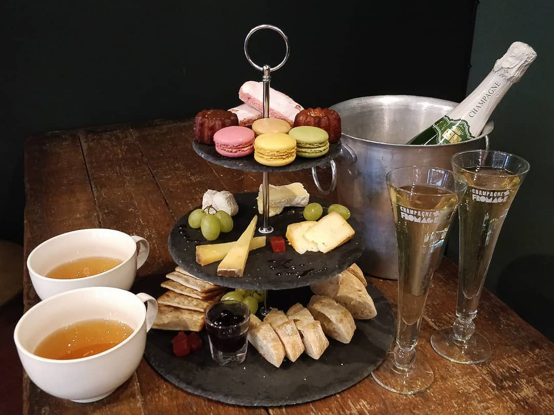 Cheese afternoon tea with champagne at Champagne and Fromage, one of the best places for cheese in London