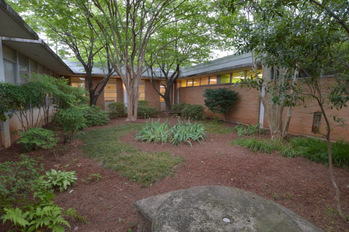 The dingy courtyard of a 1960s elementary school.