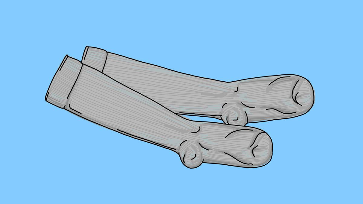 A pair of knee-high compression socks on a blue background.