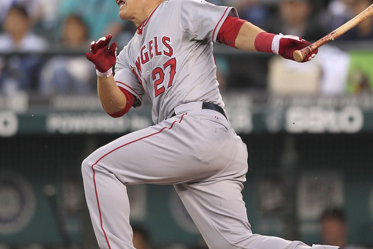 SEATTLE - AUGUST 31:  Mike Trout #27 of the Los Angeles Angels of Anaheim singles against the Seattle Mariners at Safeco Field on August 31, 2011 in Seattle, Washington. (Photo by Otto Greule Jr/Getty Images)
