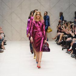 Models display designs from Burberry Prorsum's Spring/Summer 2013 collection, in Kensington, west London, during London Fashion Week, Monday Sept. 17, 2012.