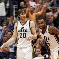 Gordon Hayward of the Utah Jazz celebrates after banking in a shot at the end of the first quarter during an NBA basketball game in Salt Lake City, Friday, April 12, 2013. At right is Mo Williams of the Utah Jazz.