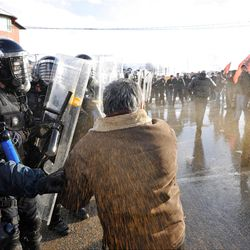 Kosovo police uses pepper spray and water canon to disperse supporters of Self-Determination (VETVENDOSJE!) during clashes in the northern Kosovo town of Podujevo on Saturday, Jan. 14, 2012. Police in Kosovo fired tear gas and used batons and a water cannon to disperse hundreds of protesters trying to enforce a trade ban on Serbian goods. ( AP Photo / Visar Kryeziu )
