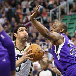 Utah Jazz center Enes Kanter (0) drives on Sacramento Kings power forward Carl Landry (24) as the Utah Jazz defeat the Sacramento Kings 106-99 in NBA basketball Monday, Jan. 27, 2014, in Salt Lake City.