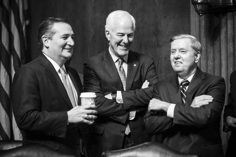 Republican Senators Ted Cruz John Cornyn and Lindsey Graham chat during a break in the hearing on the nomination of Brett Kavanaugh.