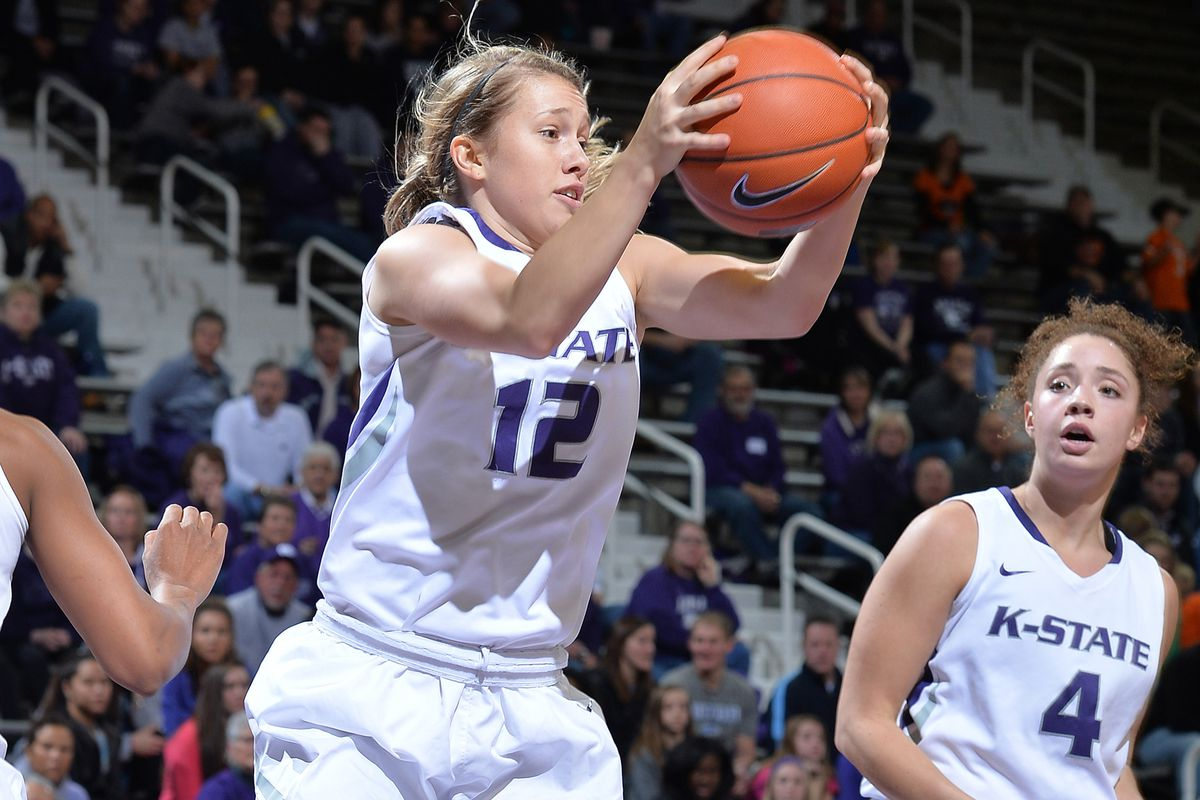 Kelly Thompson grabs a loose ball for the Wildcats
