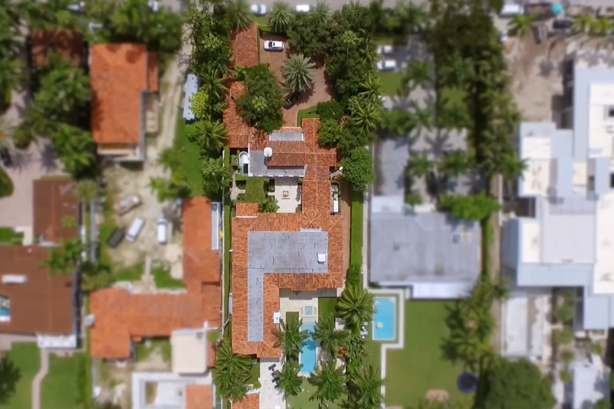aerial of a orange roof home on palm island in miami beach