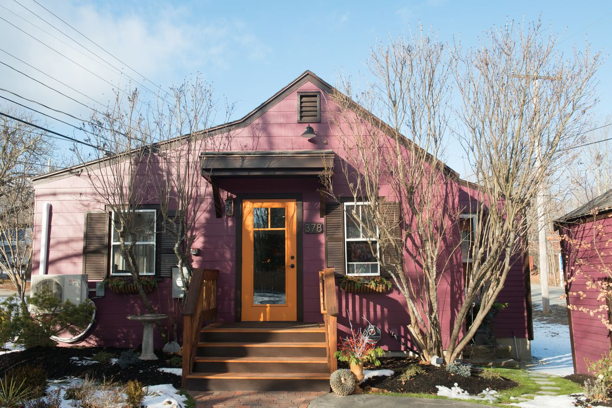 A small purple house that looks residential but is actually a bakery appropriately named the Purple House