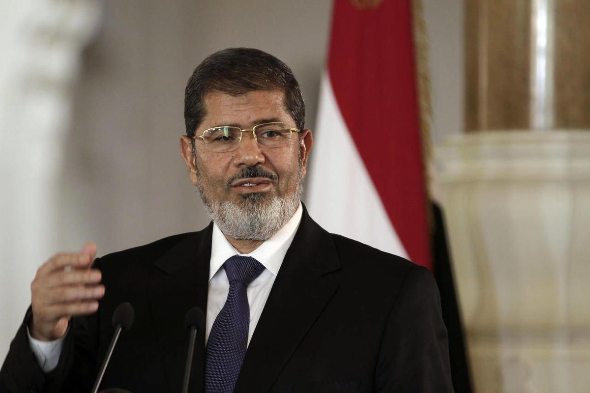 FILE - In this Friday, July 13, 2012 file photo, Egyptian President Mohammed Morsi speaks to reporters during a joint news conference with Tunisian President Moncef Marzouki, unseen, at the Presidential palace in Cairo, Egypt.  Egypt's Islamist president