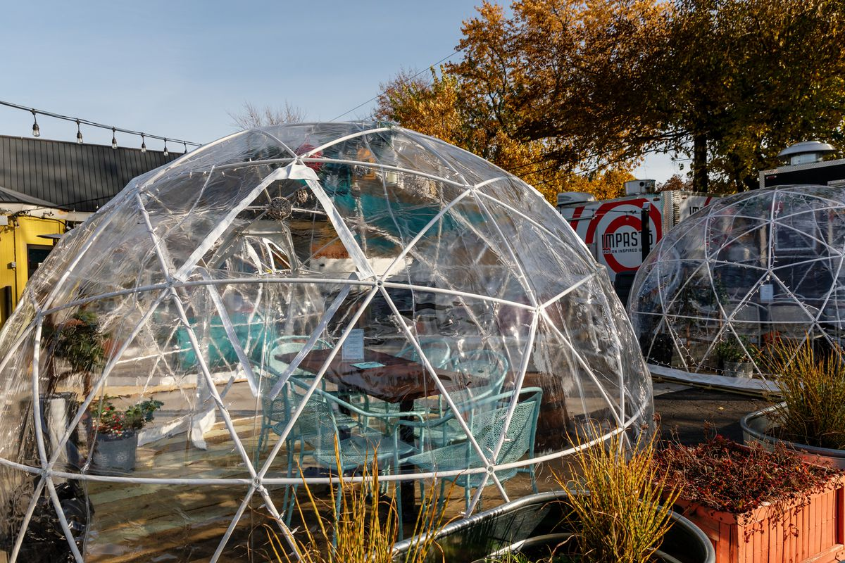 Plastic igloos shown outside of Detroit Fleat in Ferndale on a sunny day.