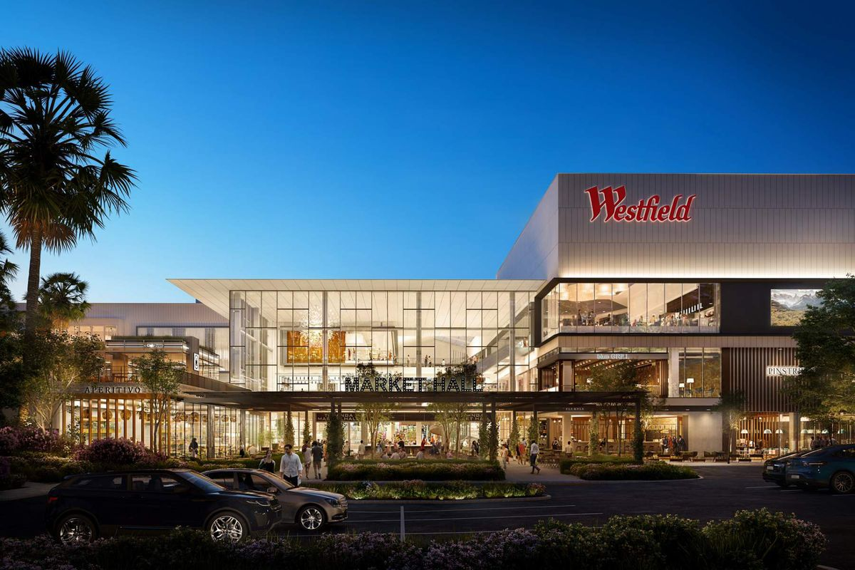 A rendering for a big, glassed-in food hall area to be built as part of a mall.