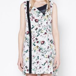 "<b>3.1 Phillip Lim</b> Asymmetric Draped Placket Dress in antique white, <a href=""http://www.31philliplim.com/shop/category/womens/dresses#asymmetric-draped-placket-dress"">$525</a>"