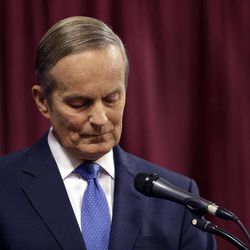 Republican Rep. Todd Akin stands at his podium at the start of the first debate in the Missouri Senate race Friday, Sept. 21, 2012, in Columbia, Mo.