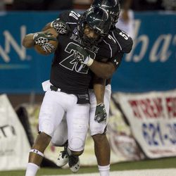 After Hawaii special teams blocked a punt, Hawaii defensive back Ne'Quan Phillip, left, and Kendrick Van Ackeren celebrate after Phillips  returned the ball for a touchdown during the second quarter of the NCAA game between the Lamar and Hawaii, Sept. 15, 2012 in Honolulu.