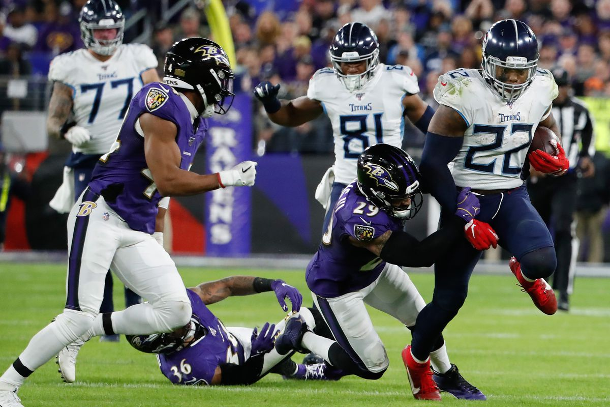 Tennessee Titans running back Derrick Henry carries the ball past Baltimore Ravens free safety Earl Thomas in a AFC Divisional Round playoff football game at M&T Bank Stadium.