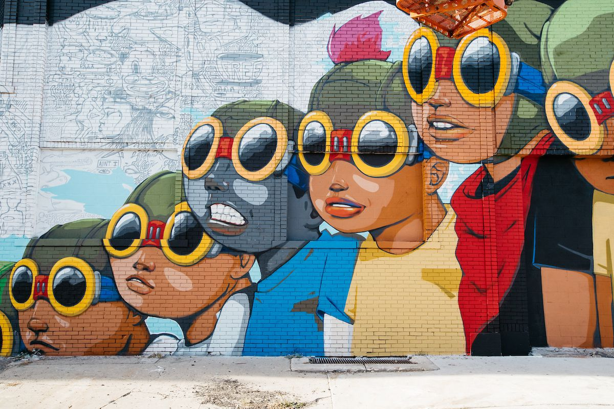 A mural depicting a group of children who are all wearing goggles.