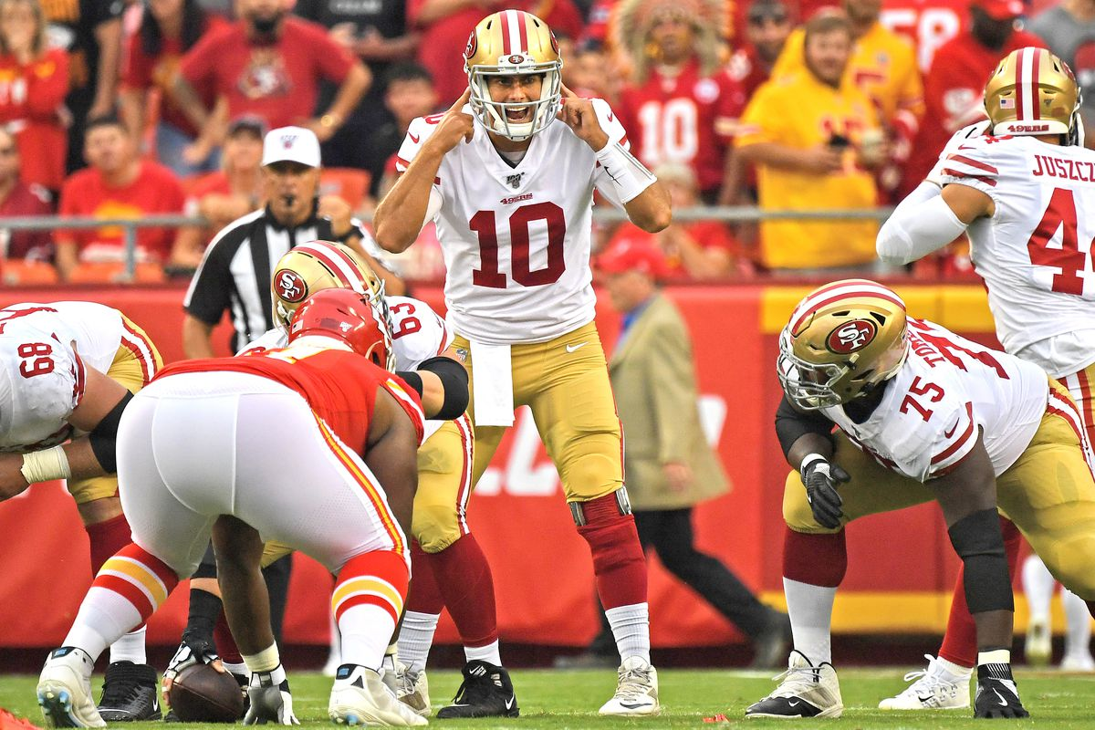 Quarterback Jimmy Garoppolo of the San Francisco 49ers calls out instructions during the first half of a pre-season game against the Kansas City Chiefs at Arrowhead Stadium on August 24, 2019 in Kansas City, Missouri.