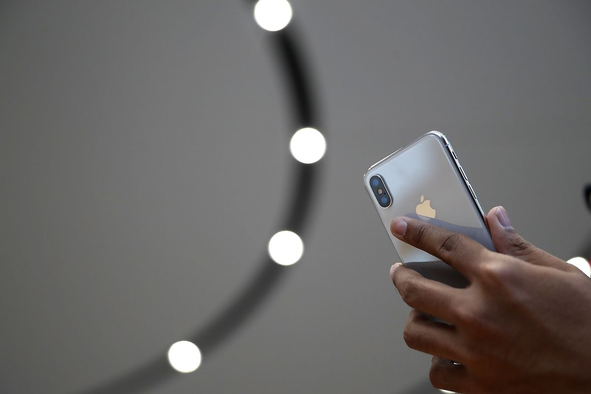 An attendee looks at a new iPhone X during an Apple special event at the Steve Jobs Theatre on the Apple Park campus on September 12, 2017 in Cupertino, California.