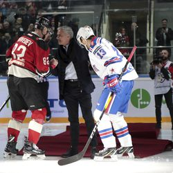 Two-time Stanley Cup winner Pavel Datsyuk of SKA St. Petersburg, right, and Yevgeni Medvedev of Avangard Omsk help former Manchester United coach Jose Mourinho, center, to get up after falling down making the first puck drop at Monday's Kontinental Hockey League game between Avangard Omsk and SKA St. Petersburg in Moscow, Russia, Monday, Feb. 4, 2019. Former Manchester United coach has ceremonially opened an ice hockey game in Russia _ and promptly fallen on the ice. (AP Photo/Dmitry Golubovich)