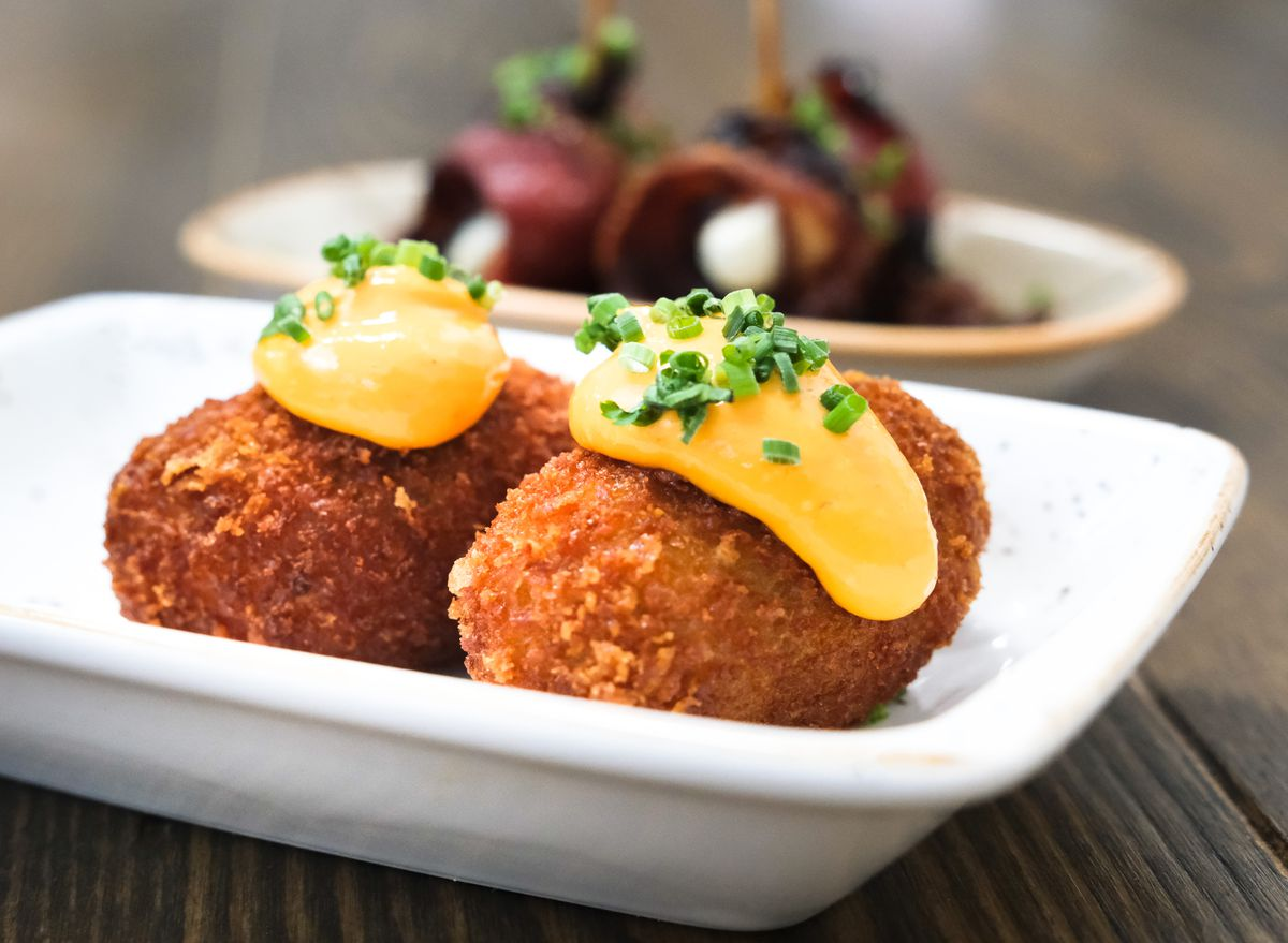 Two croquetas on a white plate