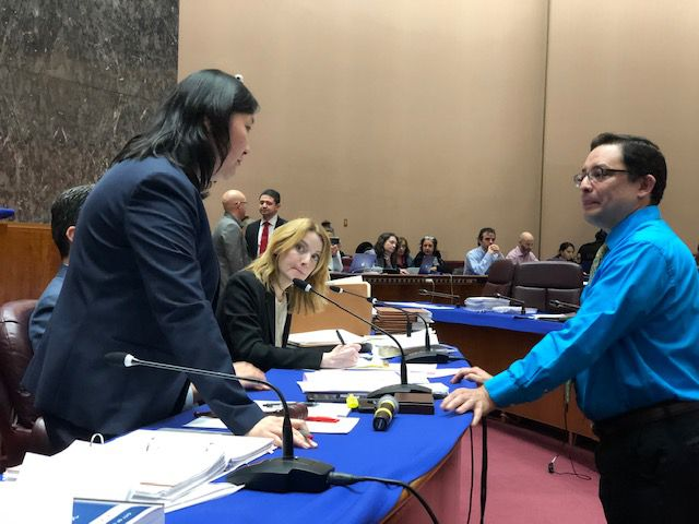 Ald. Ray Lopez (15th) (right) talks to Budget Director Susie Park (left) during a break at Tuesday's Finance Committee meeting.
