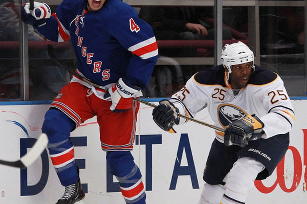 NEW YORK - NOVEMBER 11: Michael Grier #25 of the Buffalo Sabres holds up Michael Del Zotto #4 of the New York Rangers at Madison Square Garden on November 11 2010 in New York City.  (Photo by Bruce Bennett/Getty Images)