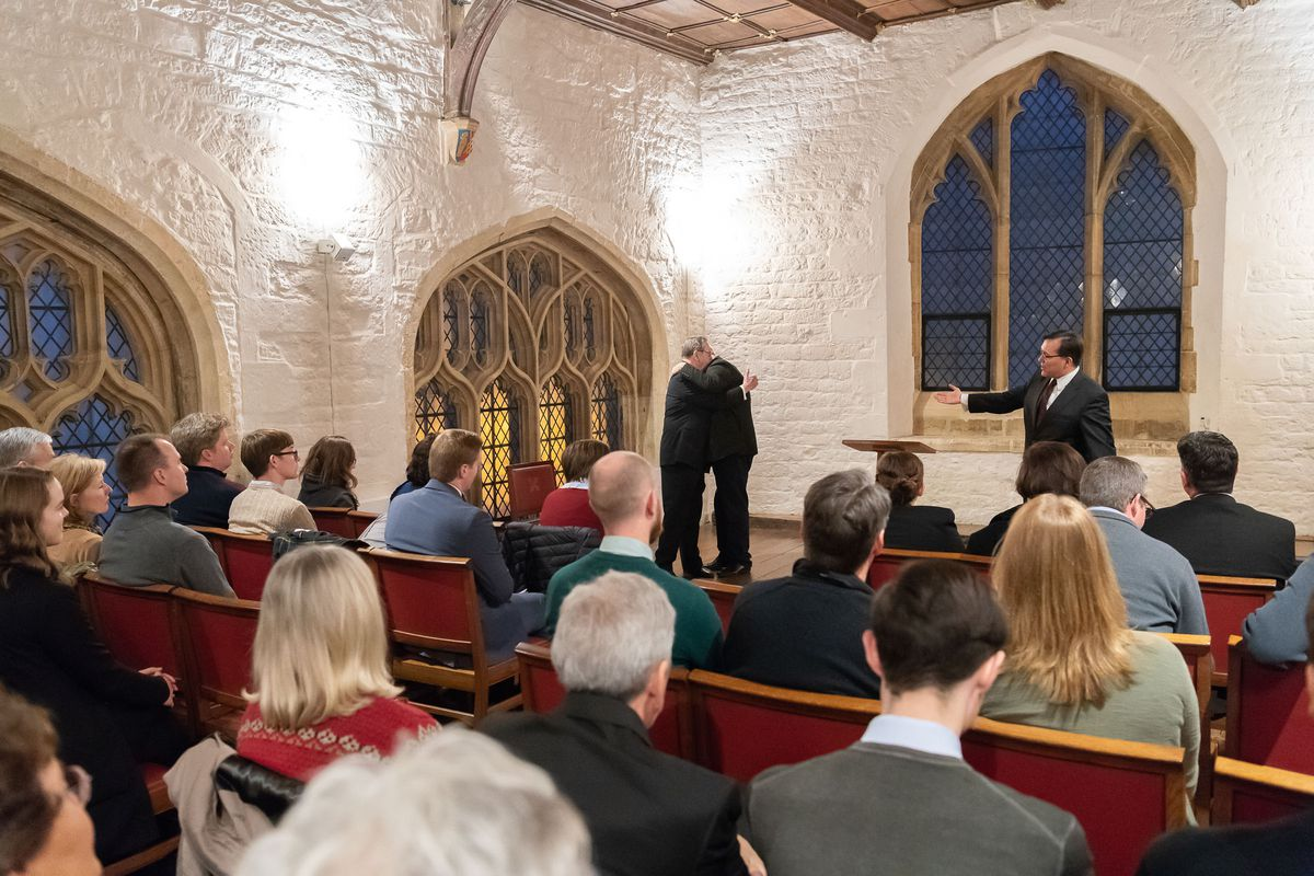 Elder Jeffrey R. Holland and the Rev. Dr. Andrew Teal embrace after their public conversation about the beliefs of The Church of Jesus Christ of Latter-day Saints at the University of Oxford's University Church of St. Mary the Virgin on Thursday, Nov. 22, 2018.
