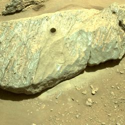 """""""Rochette,"""" the rock scientists elected as Perseverance's drilling target, is left forever with a tiny hole where the rover extracted a rock sample."""
