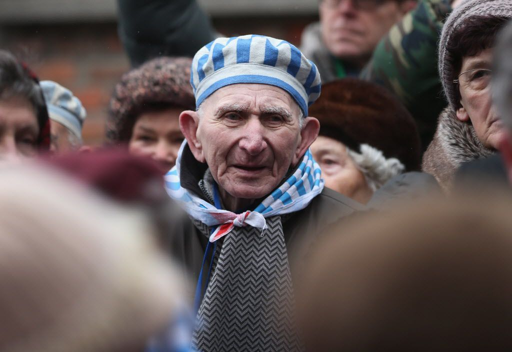 <small><strong>Members of an association of Auschwitz concentration camp survivors arrive to lay wreaths at the execution wall at the former Auschwitz I concentration camp on January 27, 2015 in Oswiecim, Poland. | Sean Gallup / Getty Images</strong></sma