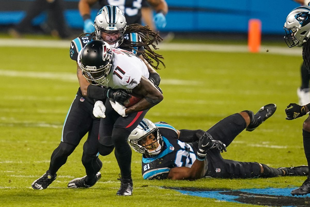 Atlanta Falcons wide receiver Julio Jones (11) is tackled after the catch by Carolina Panthers free safety Tre Boston (33) during the first quarter at Bank of America Stadium.