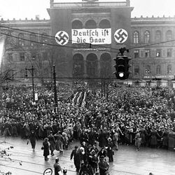 Some of the thousands of people who gathered outside the station in Berlin, Jan. 15, 1935, to welcome the Germans who voted in the Plebiscite in Saar. The vote was 90.8 precent in favor of returning Saarland to a German government.