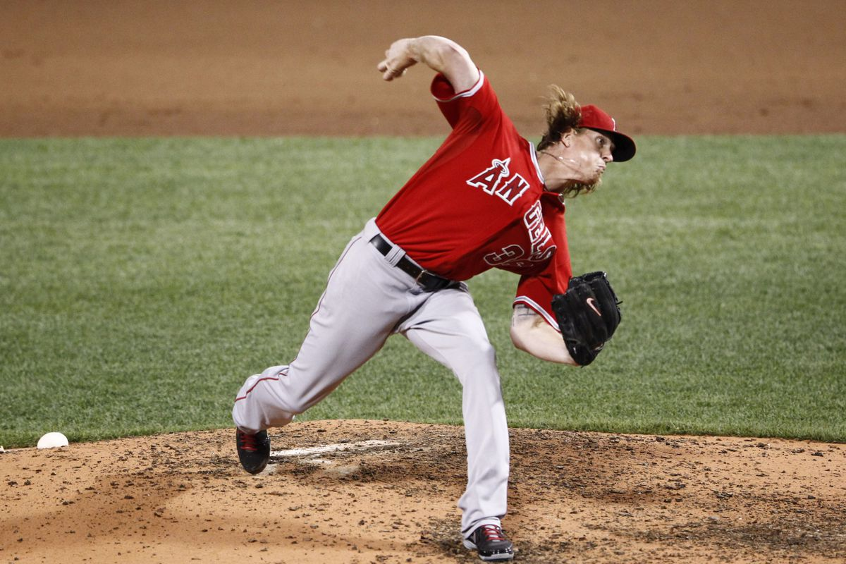 Aug 22, 2012; Boston, MA, USA; Los Angeles Angels starting pitcher Jered Weaver (36) pitches against the Boston Red Sox during the sixth inning at Fenway Park.  Mandatory Credit: Mark L. Baer-US PRESSWIRE