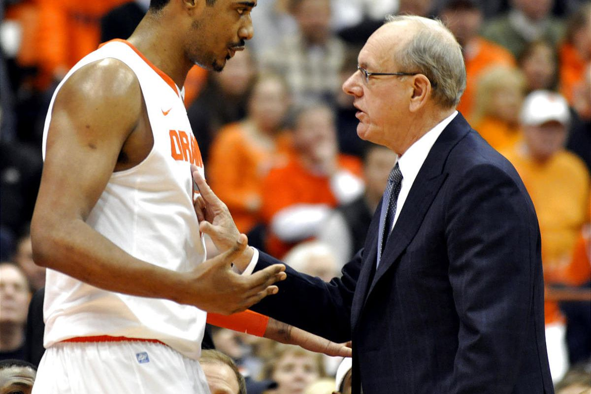 FILE - In this Jan. 15, 2011, file photo, Syracuse head coach Jim Boeheim, right, talks with Fab Melo during the first half against Cincinnati in an NCAA college basketball game in Syracuse, N.Y. Melo did not travel with the team to Pittsburgh and the uni