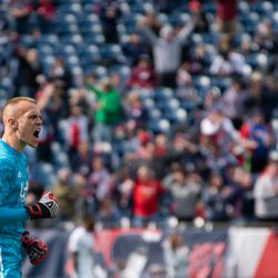 FOXBOROUGH, MA - MARCH 30: New England Revolution gaolkeeper Cody Cropper #1 pumps his fist and yells after defender Brandon Bye scored for the New England Revolution at Gillette Stadium on March 30, 2019 in Foxborough, Massachusetts. (Photo by J. Alexander Dolan - The Bent Musket)