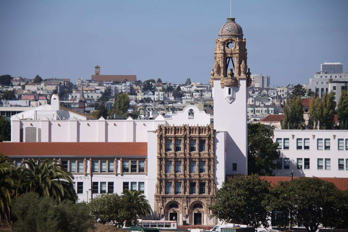 Mission High School, a mission revival building with an elaborate baroque bell tower.