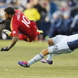 Real's Robbie Findley is brought down Kansas City's Aurelien Collin as Real Salt Lake and Sporting KC play Saturday, Dec. 7, 2013 in MLS Cup action.