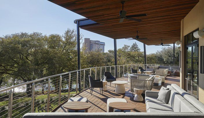 The patio overlooking trees at the Four Seasons Hotel in Austin