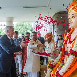 Elder D. Todd Christofferson, center left, a member of the Quorum of Twelve Apostles for The Church of Jesus Christ of Latter-day Saints, offers flowers to a statue of Saint Dnyaneshwara as he arrives at the university prior to attending an award ceremony in Pune, Maharashtra, India, on August 14, 2017.