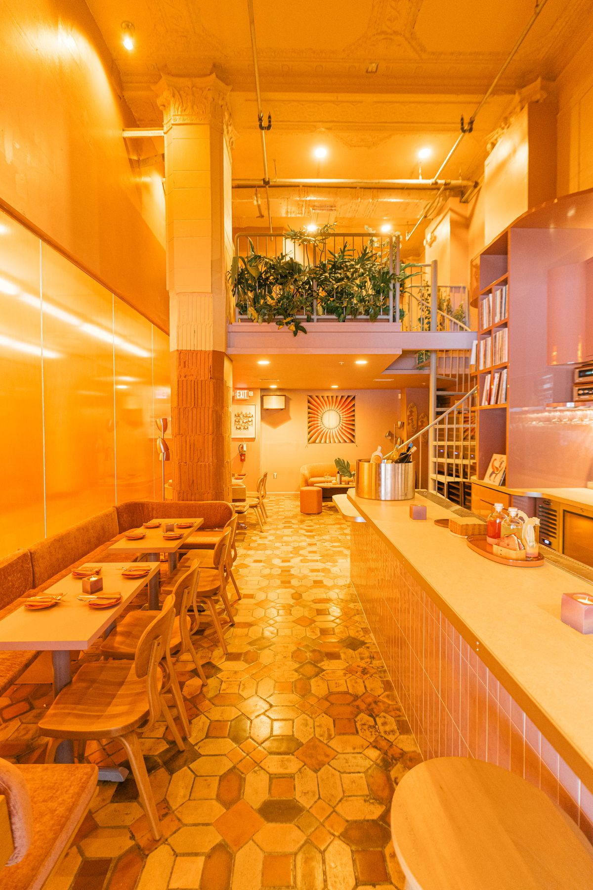 pastel interior space, wooden chairs, large bar, with views of the second floor
