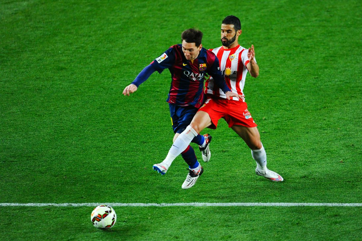 Jose Manuel Casado, pictured here tackling Lionel Messi last season, has cancelled his contract with Bolton Wanderers