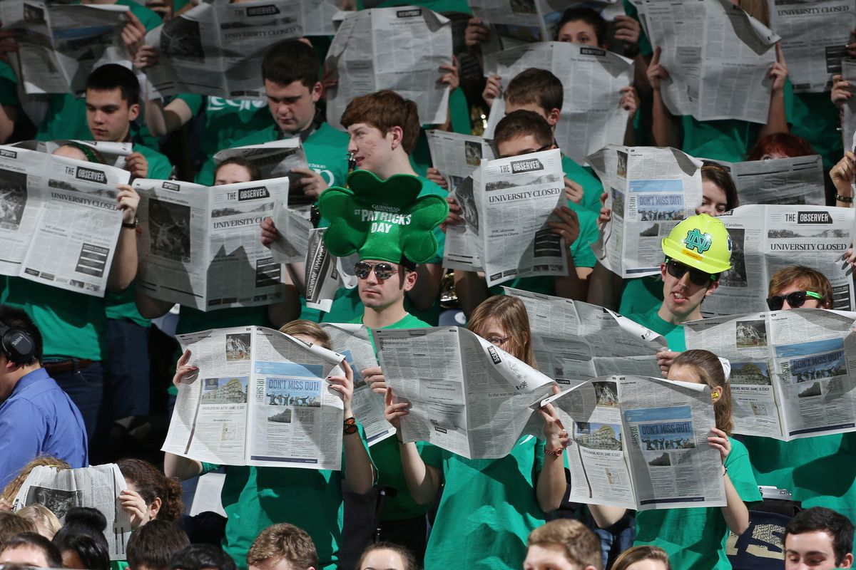 The Irish student section pouring over stat sheets