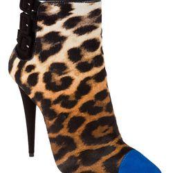 "Stiletto ankle boot, <a href=""http://www.farfetch.com/shopping/women/designer-giuseppe-zanotti-design-stiletto-ankle-boot-item-10520552.aspx"">Giuseppe Zanotti Design</a>, $971"