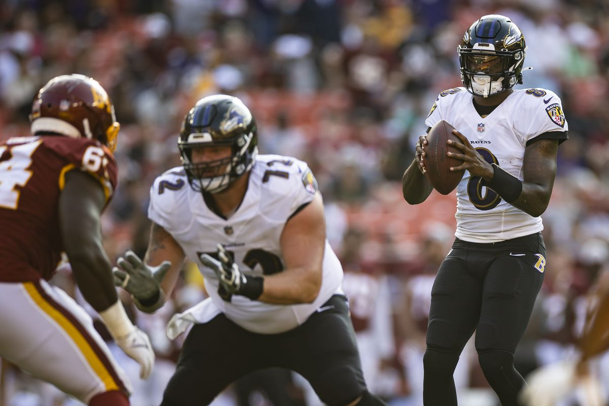 Lamar Jackson #8 of the Baltimore Ravens looks to pass against the Washington Football Team during the first half of the preseason game at FedExField on August 28, 2021 in Landover, Maryland.